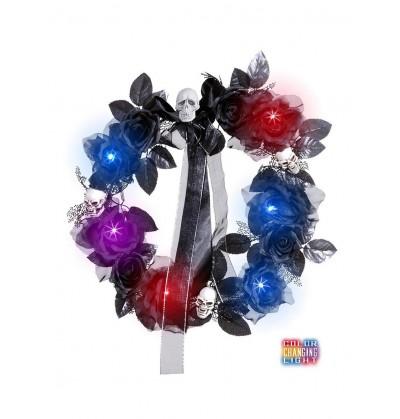 Corona de calaveras y rosas negras con luz cambiante
